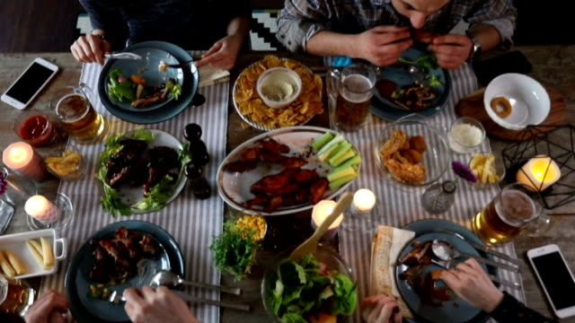 friends having new year's eve dinner at home - rustic stock videos & royalty-free footage