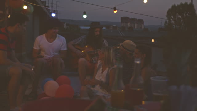 friends having rooftop party at night - singing stock videos & royalty-free footage