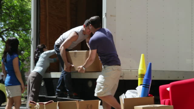 ms friends helping to unloading boxes from moving truck / newark, new jersey, united states - unloading stock videos & royalty-free footage