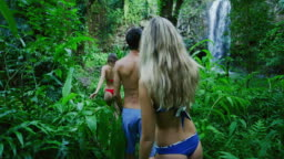 Friends Hiking to Jungle Waterfall