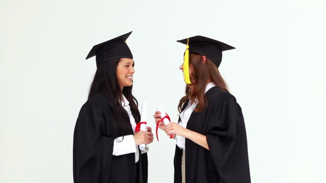 friends hugging each other after their graduation - graduation gown stock videos and b-roll footage