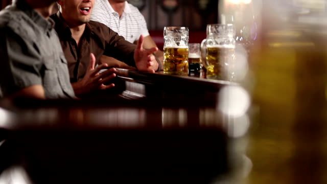 friends in the pub celebrating - fan enthusiast stock videos & royalty-free footage