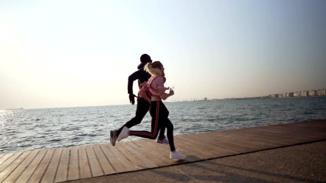 friends jogging by the sea - warm up exercise stock videos & royalty-free footage