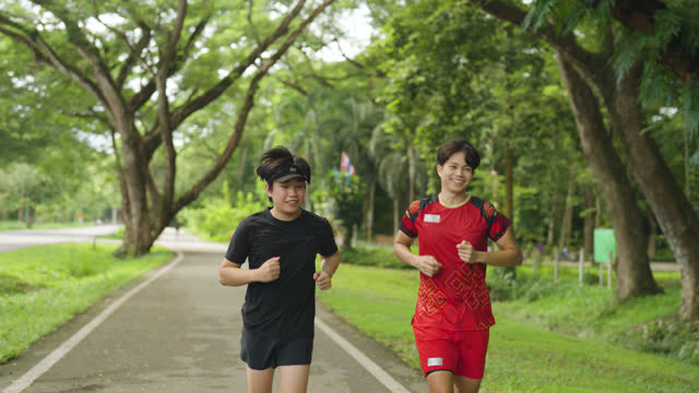 friends jogging in the park - sporting term stock videos & royalty-free footage