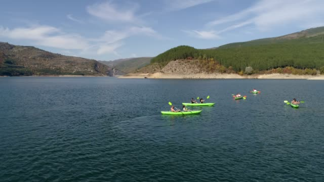 friends kayaking on a sunny day - canoeing stock videos & royalty-free footage