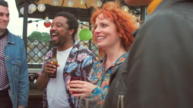 friends laughing at a party - bright stock videos & royalty-free footage