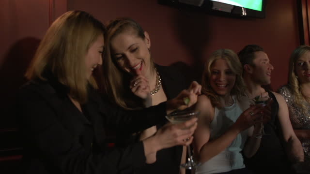 friends laughing in a nightclub lounge