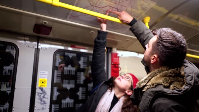 friends looking at a station map at a train - pointing stock videos & royalty-free footage