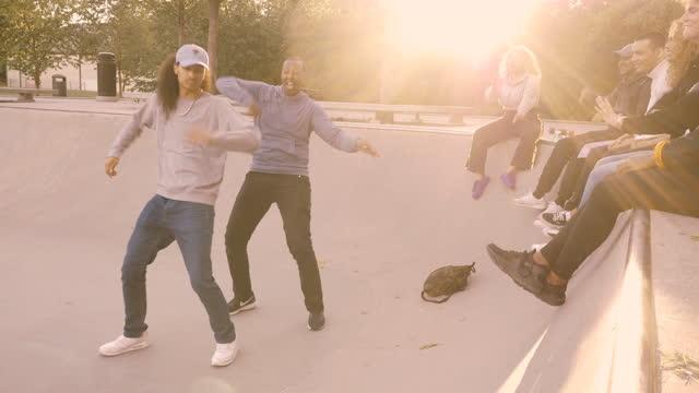 friends looking at men dancing in skateboard park - diversity stock videos & royalty-free footage
