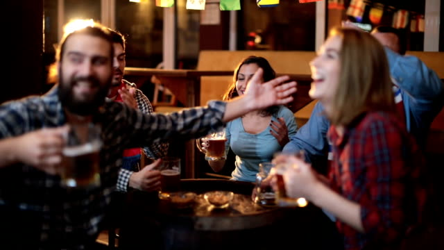 friends love sports - social gathering stock videos & royalty-free footage