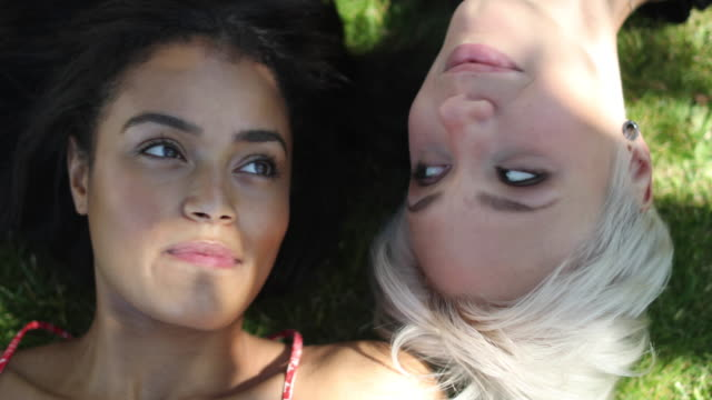 friends lying on grass - lying on back stock videos and b-roll footage