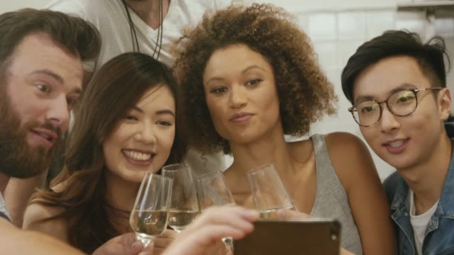 friends making a group selfie during birthday celebration - social gathering stock videos & royalty-free footage
