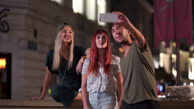 friends making selfie and capturing the moment - male with group of females stock videos & royalty-free footage