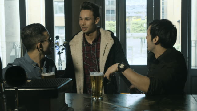 friends meeting at the bar - male friendship stock videos and b-roll footage