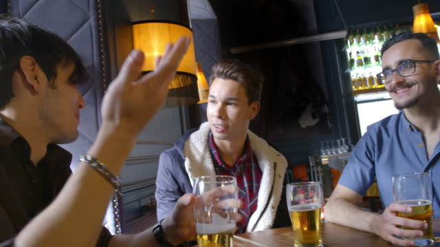 friends meeting at the bar - english culture stock videos & royalty-free footage