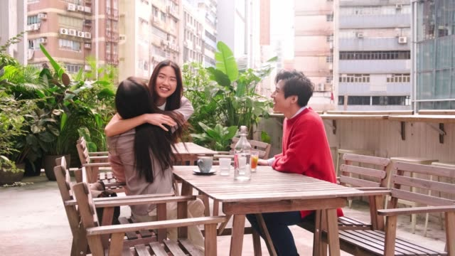 friends meeting in outdoor cafe in hong kong - building terrace stock videos & royalty-free footage