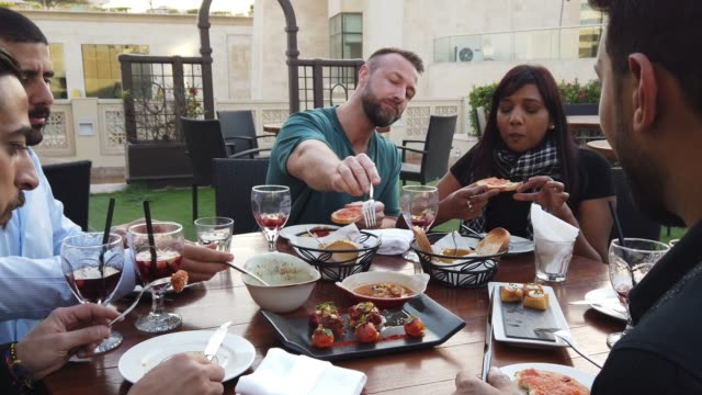 friends meeting over a friday brunch at a rooftop restaurant in dubai - brunch stock videos & royalty-free footage