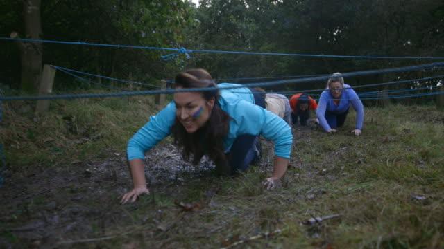 friends muddy crawl - ethnicity stock videos & royalty-free footage