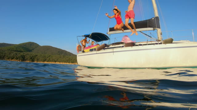 friends on a sailing boat - tuscany stock videos & royalty-free footage