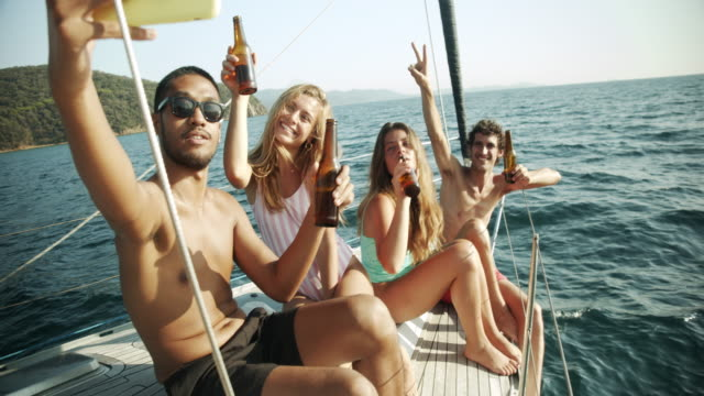 friends on a sailing boat - beer bottle stock videos & royalty-free footage