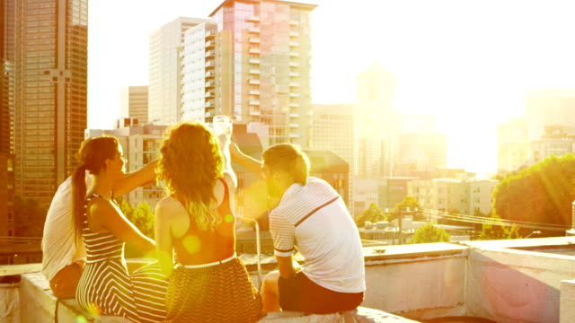 friends on rooftop deck - twilight stock videos & royalty-free footage