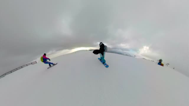Friends on snowboards enjoying a ride on a snowy mountain