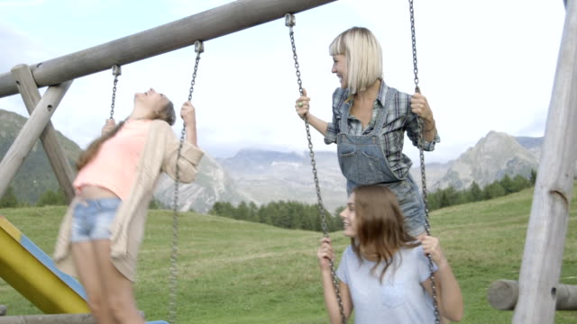 friends on swings in countryside - north tirol stock videos & royalty-free footage