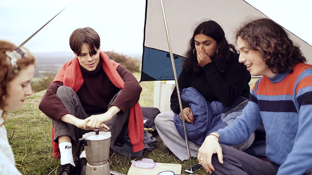 friends outside their tent on a camping trip sharing a joke - east sussex stock videos & royalty-free footage