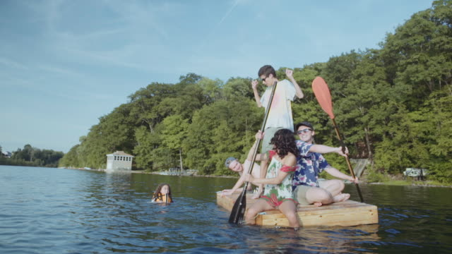 friends paddling on floating dock in lake - diving platform stock videos and b-roll footage