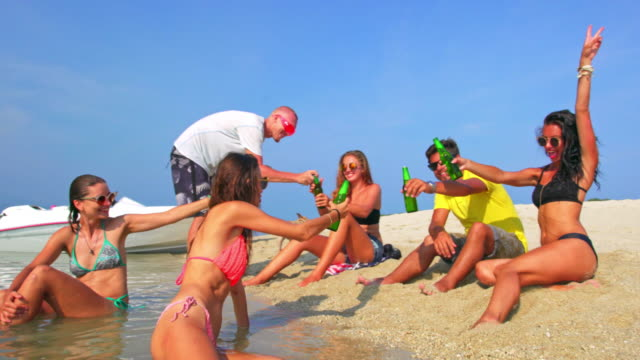 friends party on the beach 4k - ko samui stock videos and b-roll footage