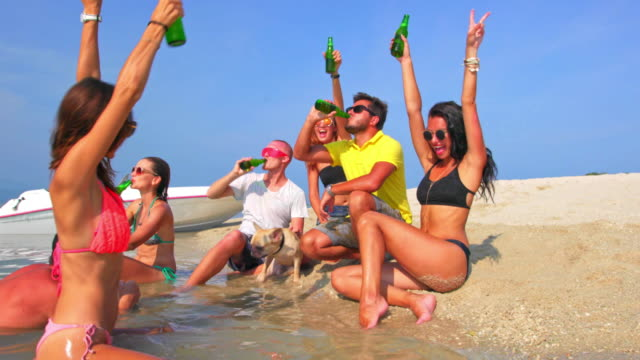 friends party on the beach 4k - ko samui stock videos & royalty-free footage