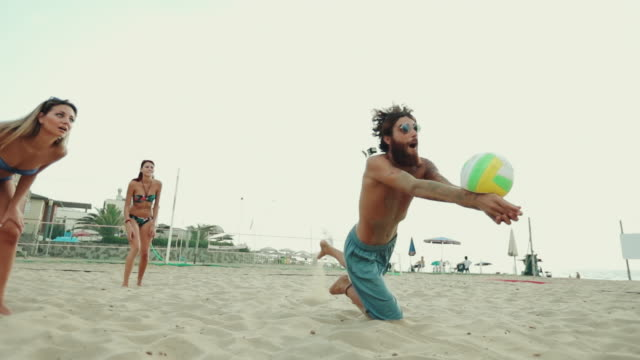 friends play beach volley and have fun - volleyball sport stock videos and b-roll footage