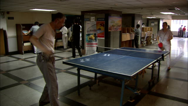 friends play ping pong in a recreation centre, china. available in hd. - table tennis stock videos and b-roll footage