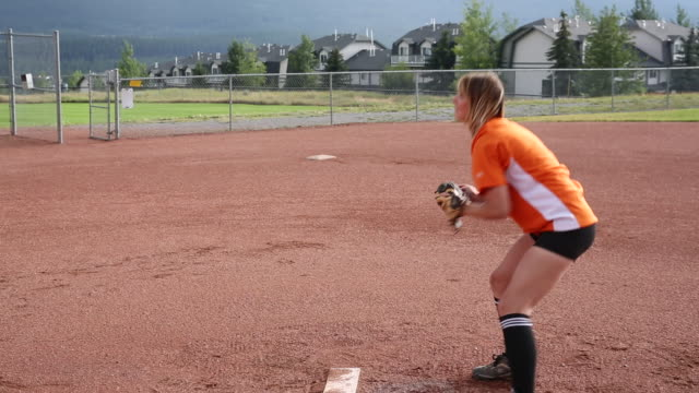 friends play softball in designated baseball pitch - baseball sport stock videos & royalty-free footage