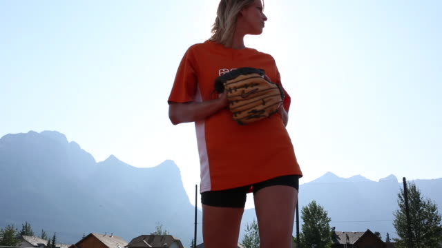 friends play softball in designated baseball pitch - pitch stock videos & royalty-free footage