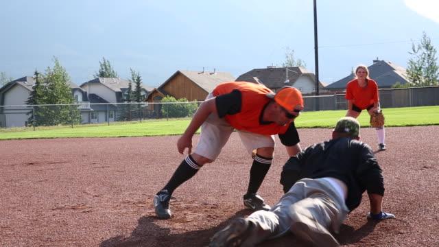 friends play softball in designated baseball pitch - baseball diamond stock videos & royalty-free footage