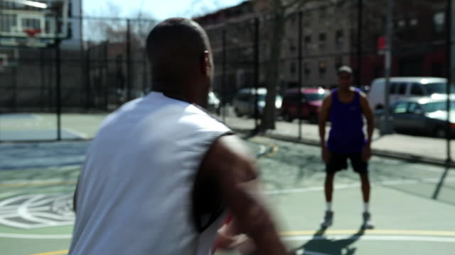 ms tu friends playing basketball / brooklyn,new york,united states - newoutdoors stock videos & royalty-free footage