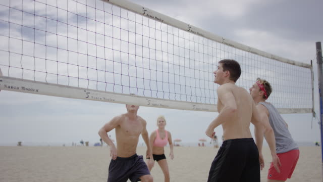 friends playing beach volleyball - volleyball sport stock videos and b-roll footage