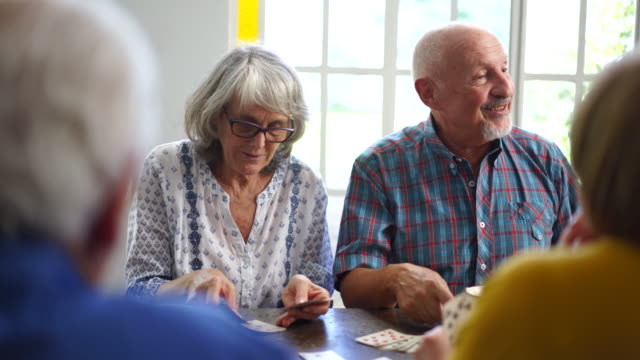 friends playing cards in nursery home - social gathering stock videos & royalty-free footage