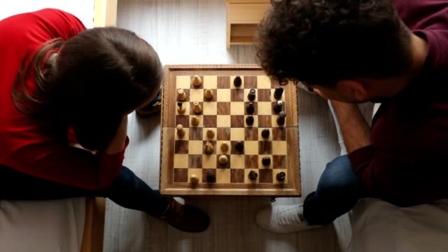 friends playing chess in the hostel room - rivalry stock videos & royalty-free footage