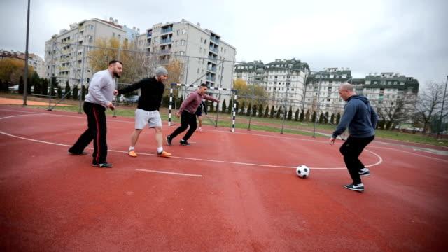 Friends playing dootball