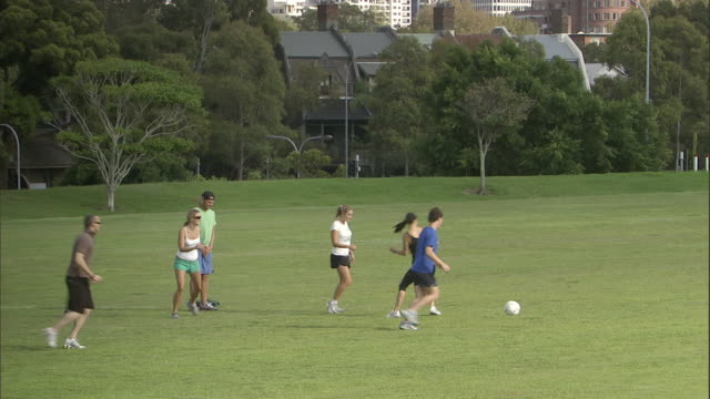 ws, pan, friends playing soccer in park, sydney, australia - kicking stock videos & royalty-free footage