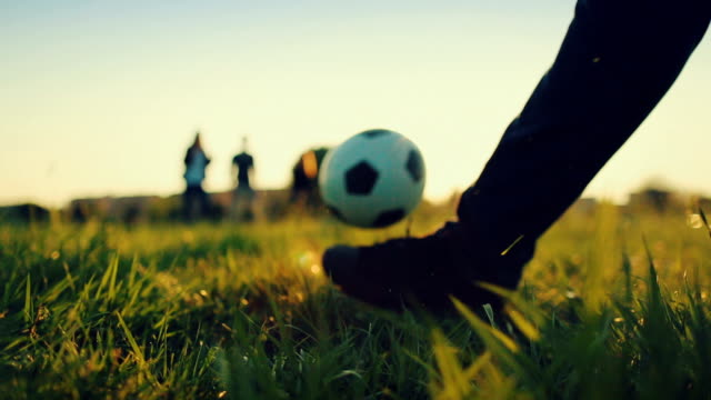 friends playing soccer on a field - kicking stock videos & royalty-free footage