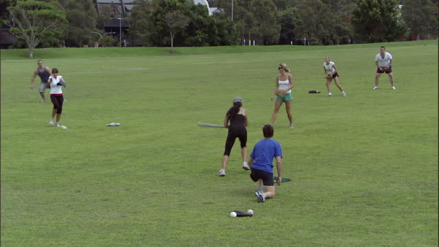 ws, td, pan, friends playing softball in park, sydney, australia - 30 34 years stock videos & royalty-free footage