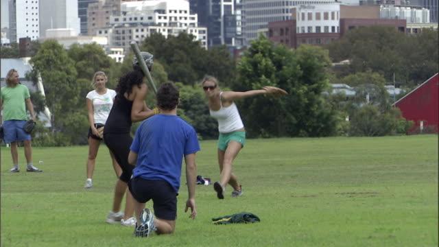 vídeos y material grabado en eventos de stock de ms, friends playing softball in park, sydney, australia - sófbol