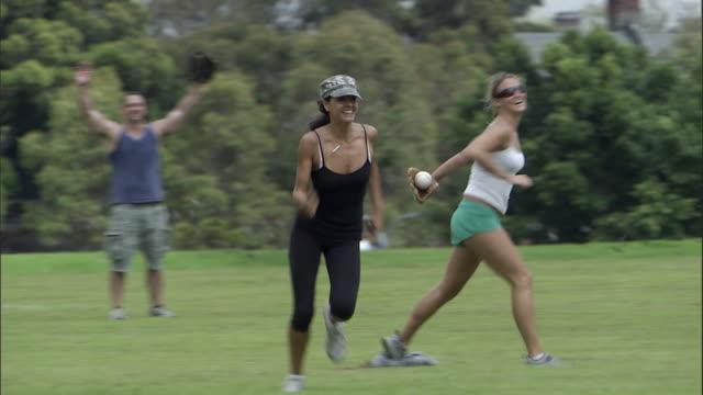 vídeos y material grabado en eventos de stock de ms, pan, friends playing softball in park, sydney, australia - sófbol