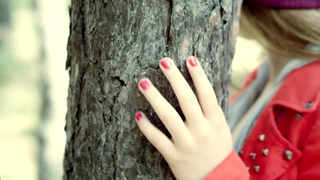 friends playing tag in the woods. close up woman hiding behind tree - playing tag stock videos & royalty-free footage