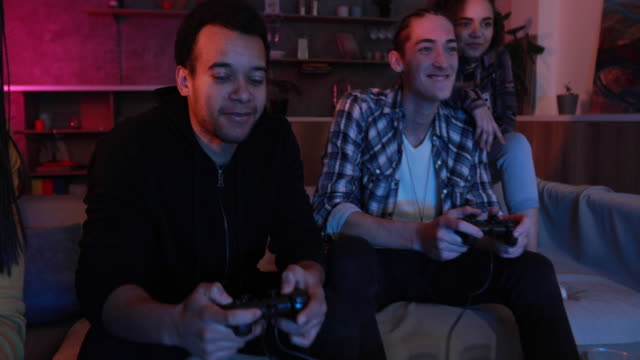 friends playing video games at home - gamer stock videos & royalty-free footage