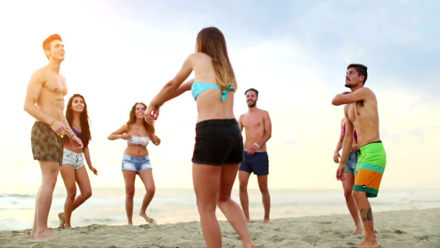 friends playing volley on the beach - volleyball sport stock videos and b-roll footage