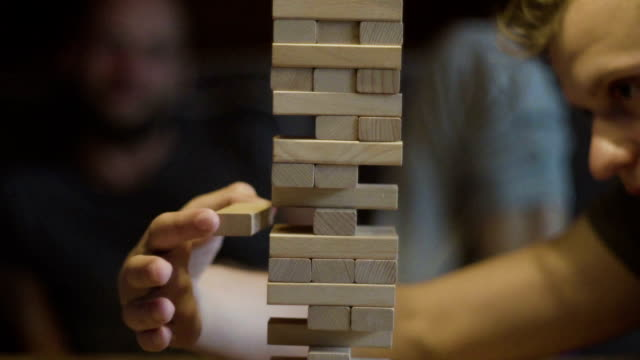 friends playing with the wood game. risk metaphore - strategy stock videos & royalty-free footage
